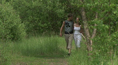 Ð¡ouple walking in the park Stock Footage