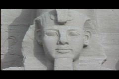 Abu simbel exterior statue heads pan l to r Stock Footage