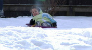 Stock Video Footage of Winter Sledding Fun 1289