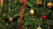 Christmas tree decorated with lights balls ribbons and ornaments. Stock Footage
