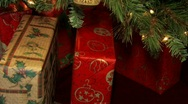Gifts under a decorated Christmas tree.   Stock Footage