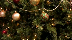 Christmas tree decorated with lights balls ribbons and ornaments. - stock footage