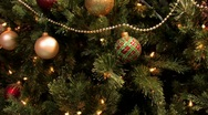Stock Video Footage of Christmas tree decorated with lights balls ribbons and ornaments.