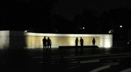 People Walking in front of World War 2 Memorial at Night Stock Footage