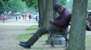 Stock Video Footage of Old Man Sleeping on Bench in DC out of Focus