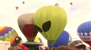 Stock Video Footage of Hot Air Balloon Mass Ascension With Alien Balloon