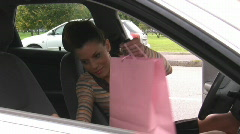 Woman with shopping bags in car Stock Footage
