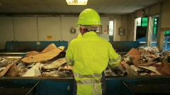 Trash Sorter in Recycle Center - stock footage