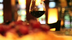 glass of wine with raisin - stock footage