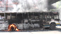 BURNING BUS in Riot Street CIVIL WAR Protest Demonstration RED SHIRT Thailand  - stock footage