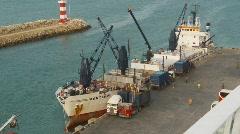 Marine transportation, cargo reefer ship at dock Stock Footage
