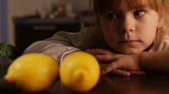 Little girl and lemons 2 Stock Footage
