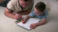 Stock Video Footage of Father Son Coloring Above