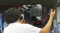film set crew, #1 with Arriflex 416 film camera on set - stock footage