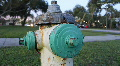 Green & Yellow Rusty Fire Hydrant - Traffic In Background HD Footage