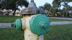 Green & Yellow Rusty Fire Hydrant - Traffic In Background Stock Footage