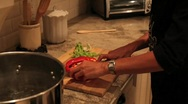 Woman cutting vegetables Stock Footage