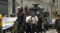 Politics and protest, protest march, Lima, Peru. Police armored car Stock Footage