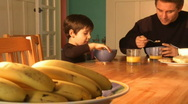 Stock Video Footage of father and son eating breakfast