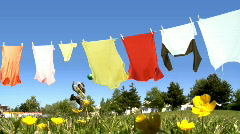 Laundry over kid playing outdoor Stock Footage