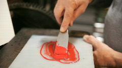 Preparing red letterpress ink Stock Footage