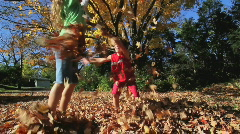 Kids in Fall Leaves 5 Stock Footage