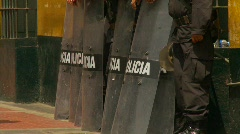 Crime and justice, police with riot shields Stock Footage