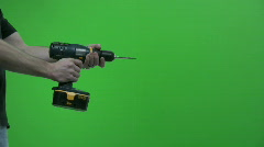 Man Drilling on a Green Screen 2 Stock Footage