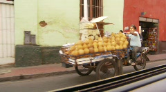 Commerce, motorbike trike with fruit in downtown Stock Footage