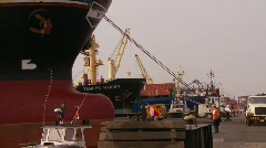 Marine transportation, cargo ships and trucks at dock, #7 Stock Footage
