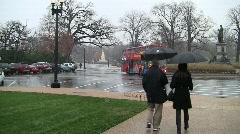 Usbg people walking away umbrellas snow 15s Stock Footage