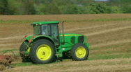 Stock Video Footage of Tractor Discing Field 02