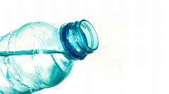 Water Pouring out of a Plastic Bottle (Aqua Hue) Stock Footage