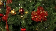 Christmas tree with lights balls ribbons and ornaments. Stock Footage