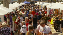 people milling about in open air market - stock footage