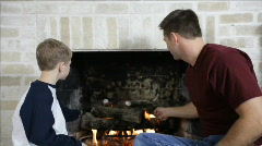 Dad Roasting Marshmallows with His Son Stock Footage