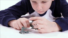 Rack focus boy playing with toy soldiers Stock Footage