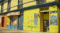 Streetlife yellow building background Stock Footage
