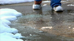 Homeowner Spreading Salt on Icy Sidewalk in the Winter Stock Footage