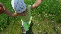 First person view from man rotates little girl in park Stock Footage