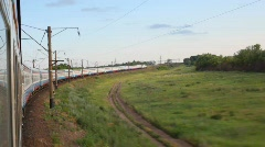 Country road and surrounding nature, view from moving train Stock Footage