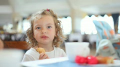 Cute little girl eating chocolate ice cream in cafe, tight dof Stock Footage