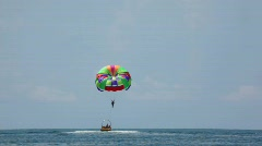 Parasailing on sea, cutter have man with parachute in tow Stock Footage