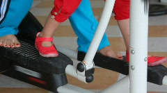 Legs of woman and little girl training on gym apparatus Stock Footage