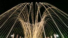 Spurts of fountain with illuminance, night street of Sochi, Russia Stock Footage