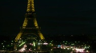 Stock Video Footage of View on night city with illuminated Tour Eiffel on the center on dark sky.