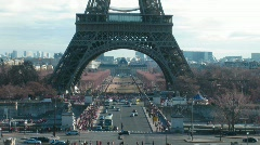 Movement under Tour Eiffel in a current of day: cars, tourists. Paris Stock Footage