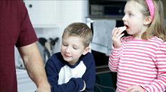 Tilt down dad and kids eating fruit Stock Footage
