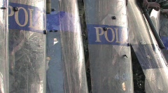 Row RIOT POLICE soldiers with POLICEMAN shields and clubs PROTEST DEMOSTRATION - stock footage