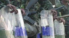 Police soldiers with riot shields and clubs. Stock Footage